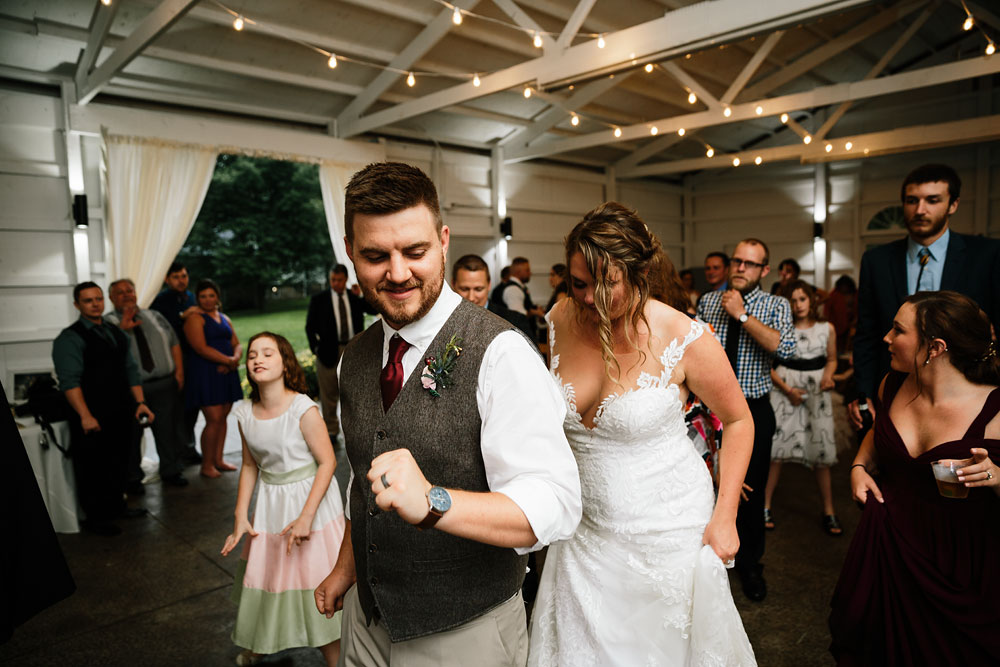 groom dancing at wedding reception at Hines Hill Conference Center in Beautiful Cuyahoga Valley National Park