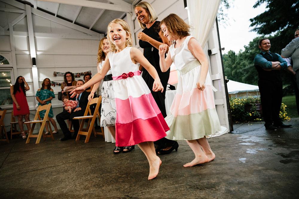 little girls dancing at wedding reception