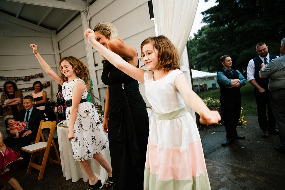 little girls dancing during wedding reception