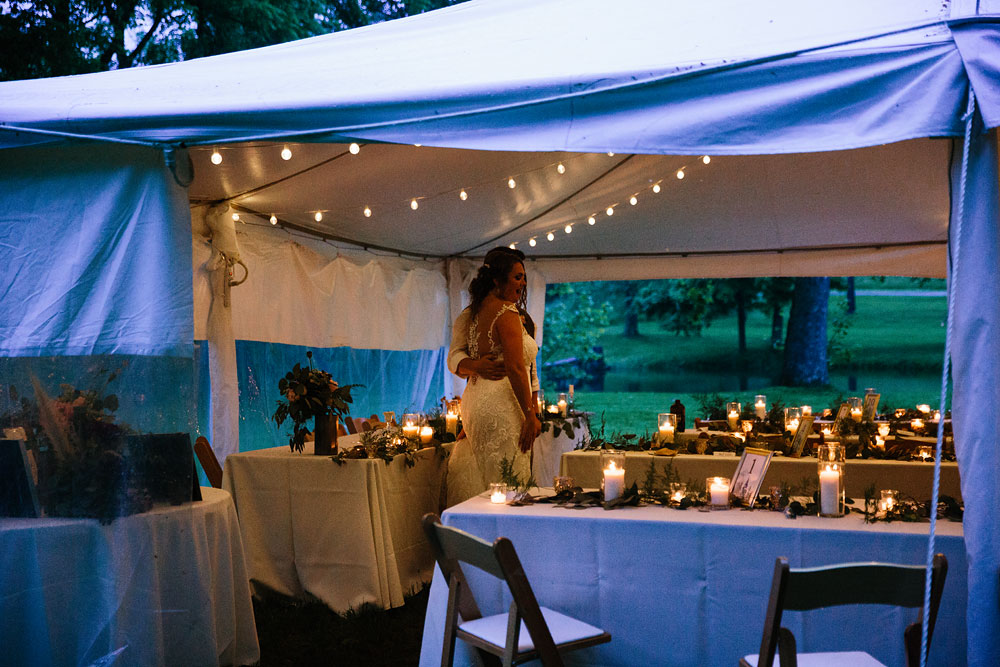 reception under tent with candles and plants as decorations