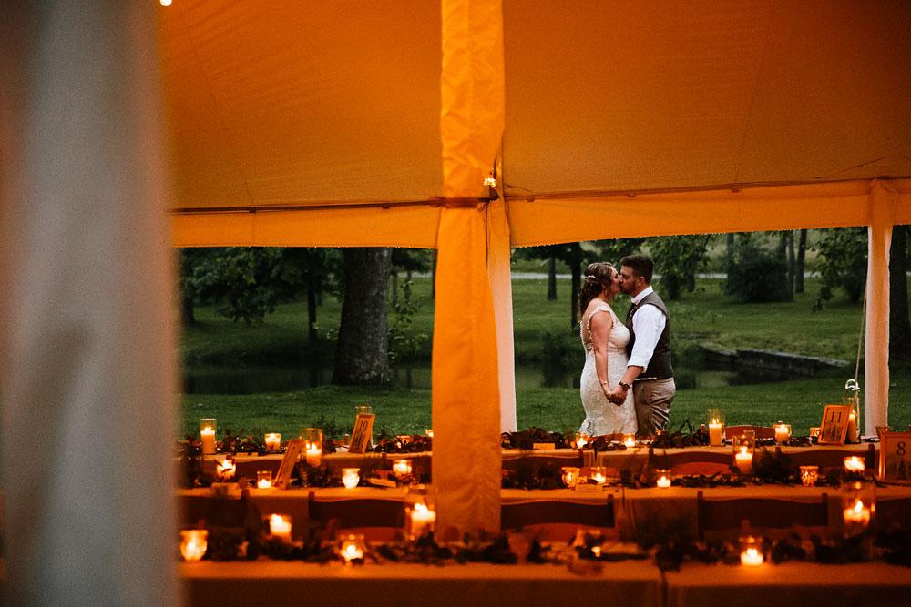 bride and groom kiss in secret