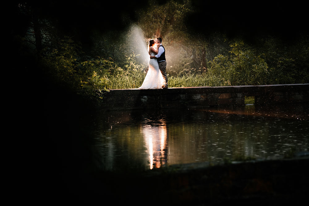 bride and groom kiss in the dark