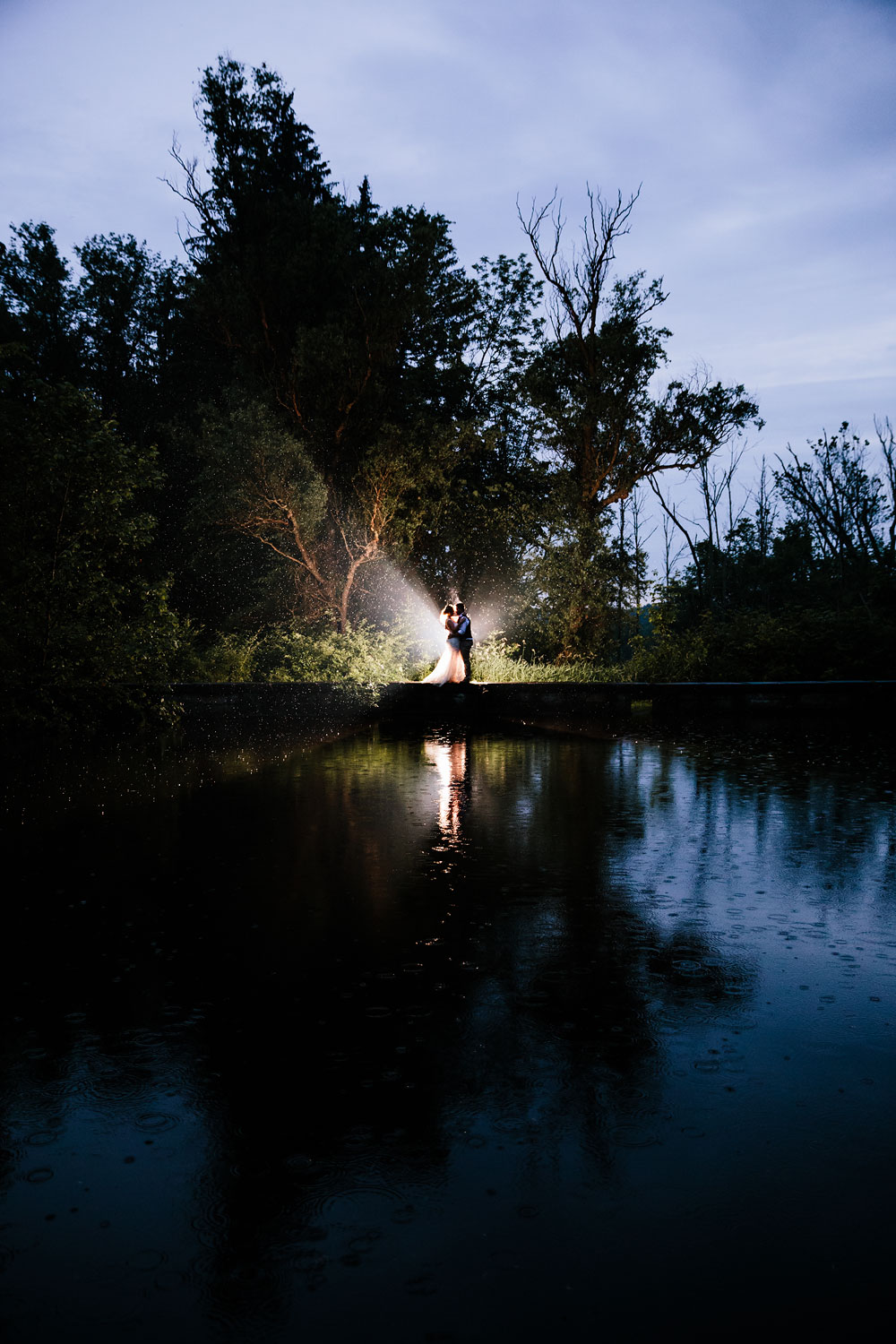 bride and groom kiss in the dark at wedding reception at Hines Hill Conference Center in Beautiful Cuyahoga Valley National Park