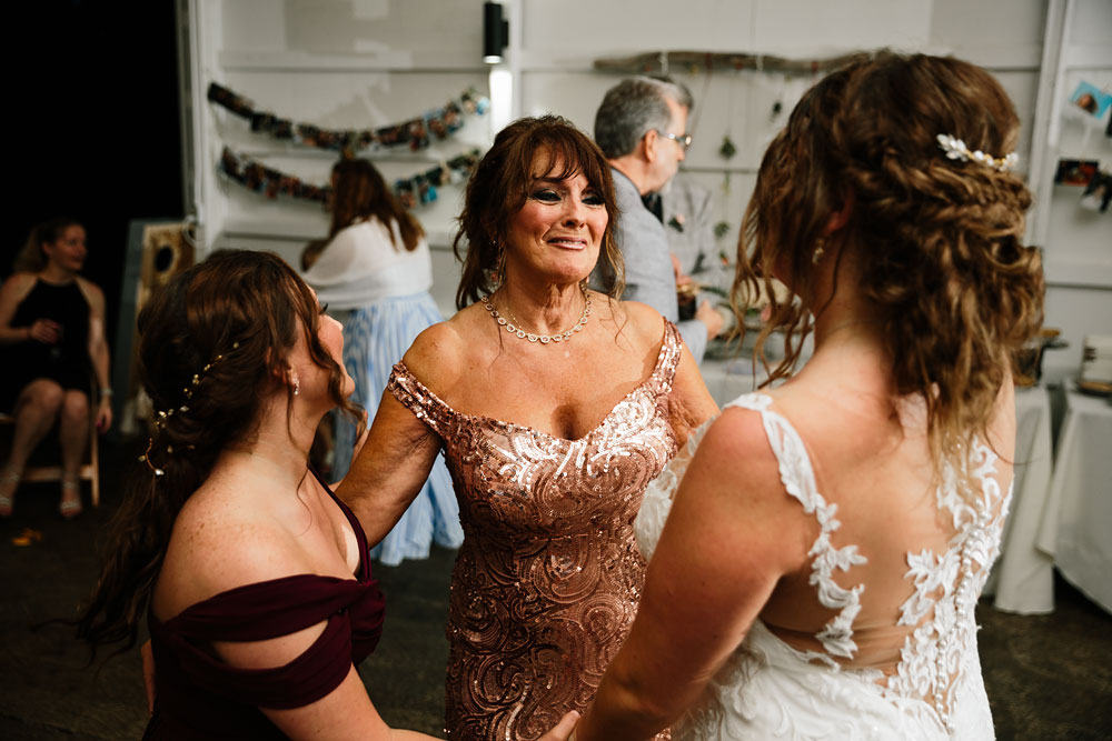 mother of bride looks at her daughter