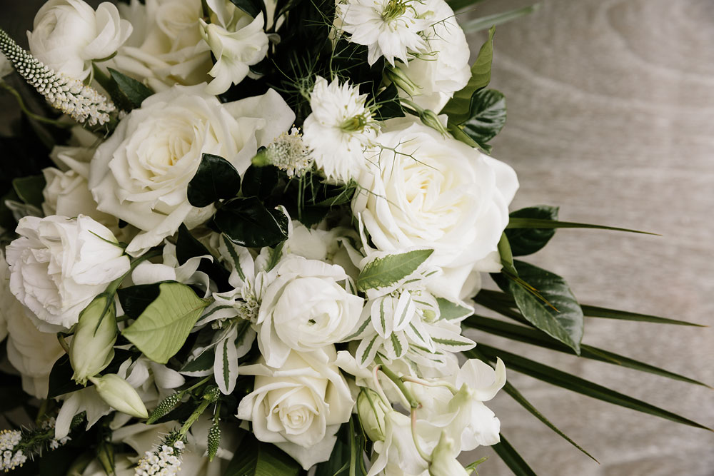 white and green bouquet greenery white roses