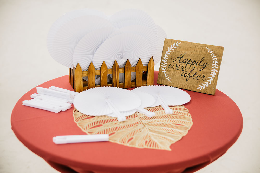 happily ever after decorations white fans laying on table