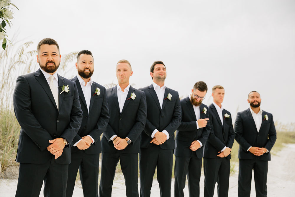 groomsmen in line for wedding on beach in Florida