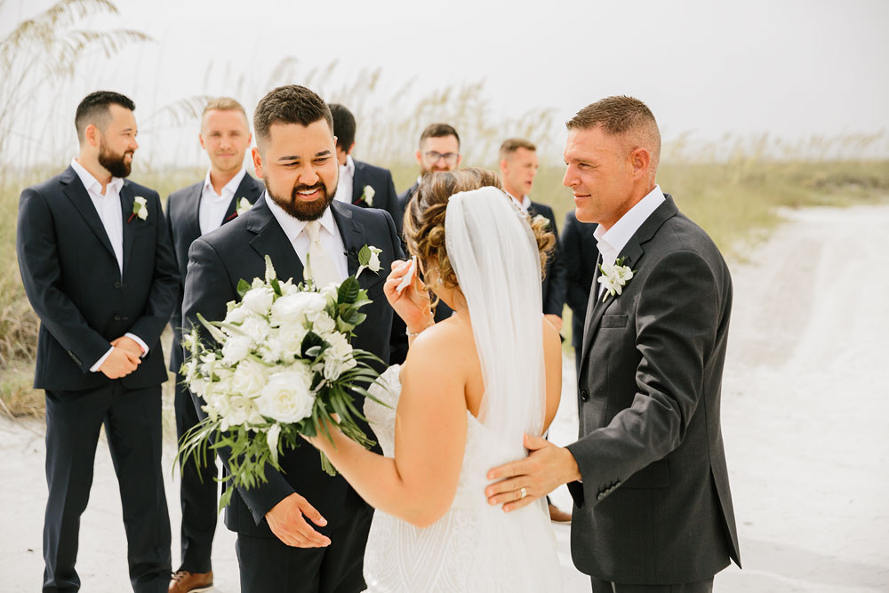 father giving away daughter at beach wedding