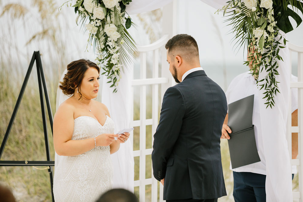 bride saying her vows to groom