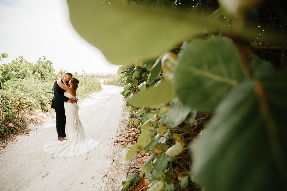 bride and groom kissing at destination wedding  at Pink Shell Resort in Fort Myers Beach, FL