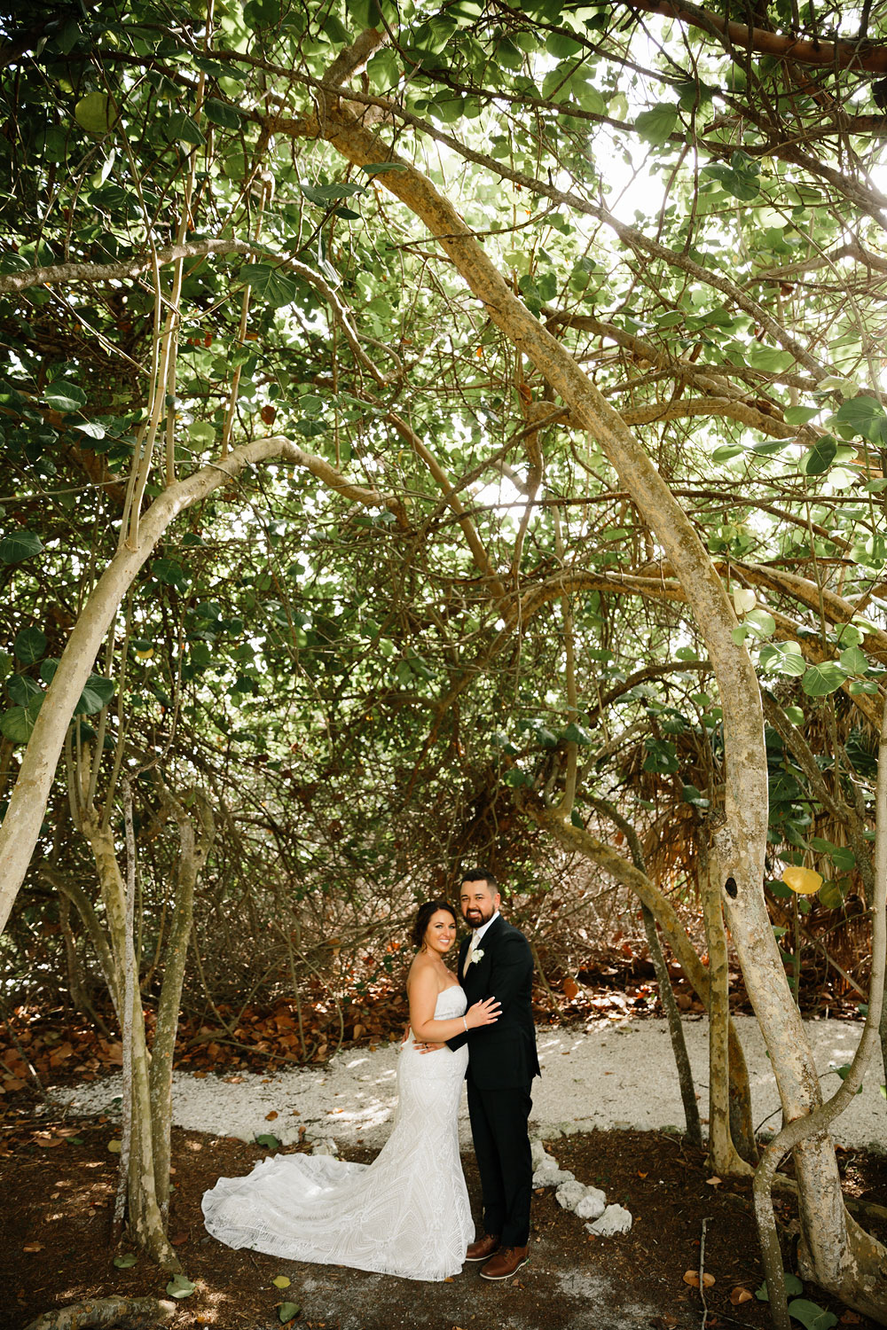 bride and groom in woods at destination wedding  at Pink Shell Resort in Fort Myers Beach, FL