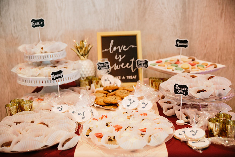 love is sweet sweets on table for wedding reception
