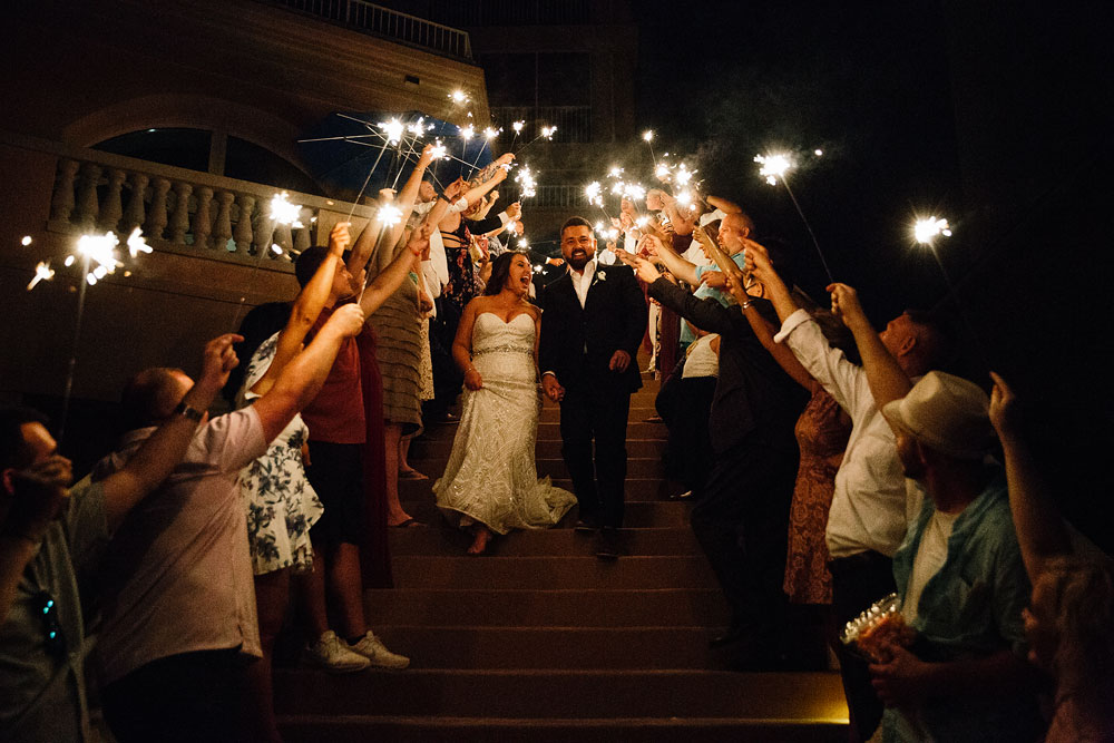 sparklers sending off bride and groom