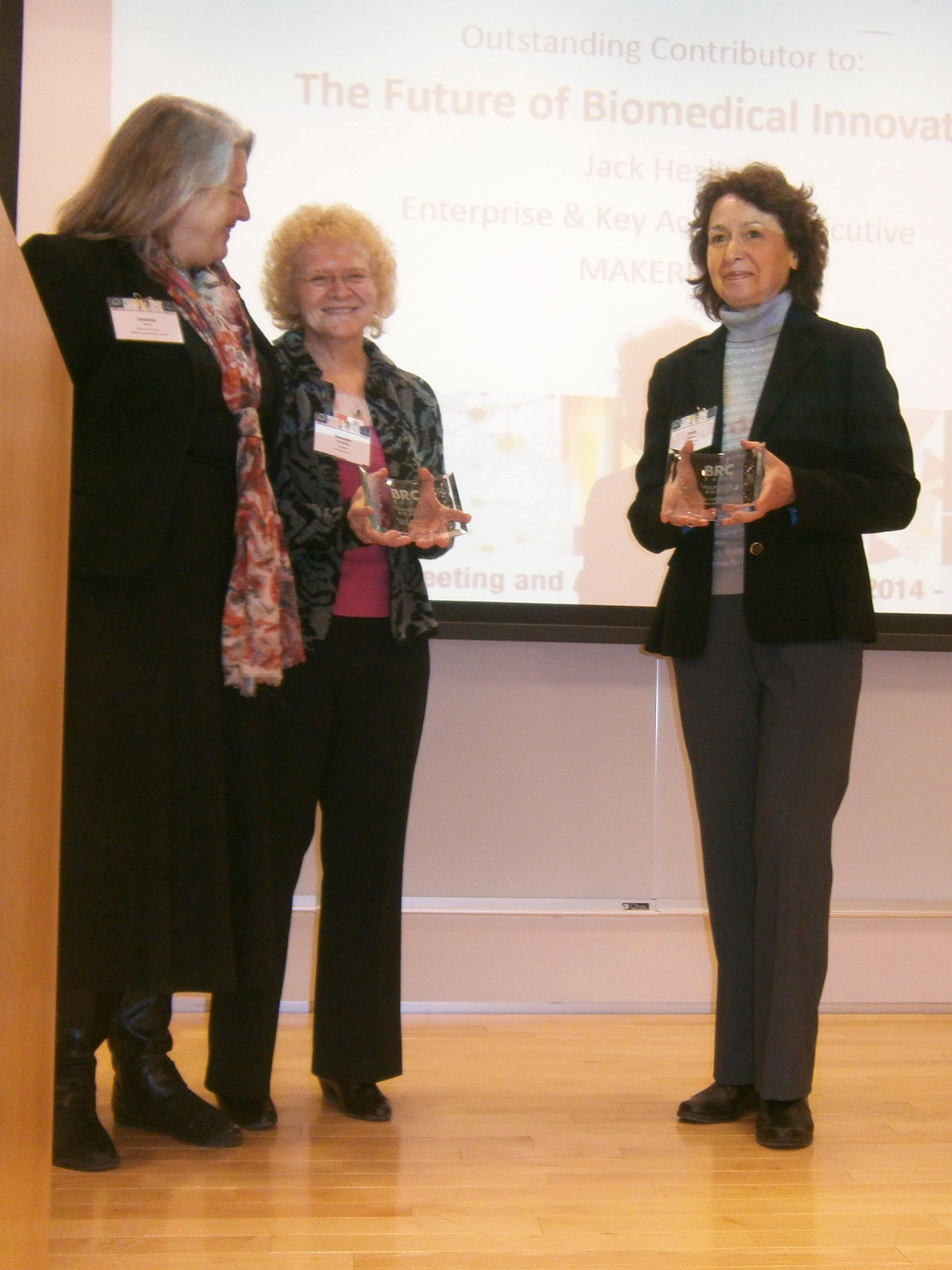 Dr. Dolly Koltchev receiving award.