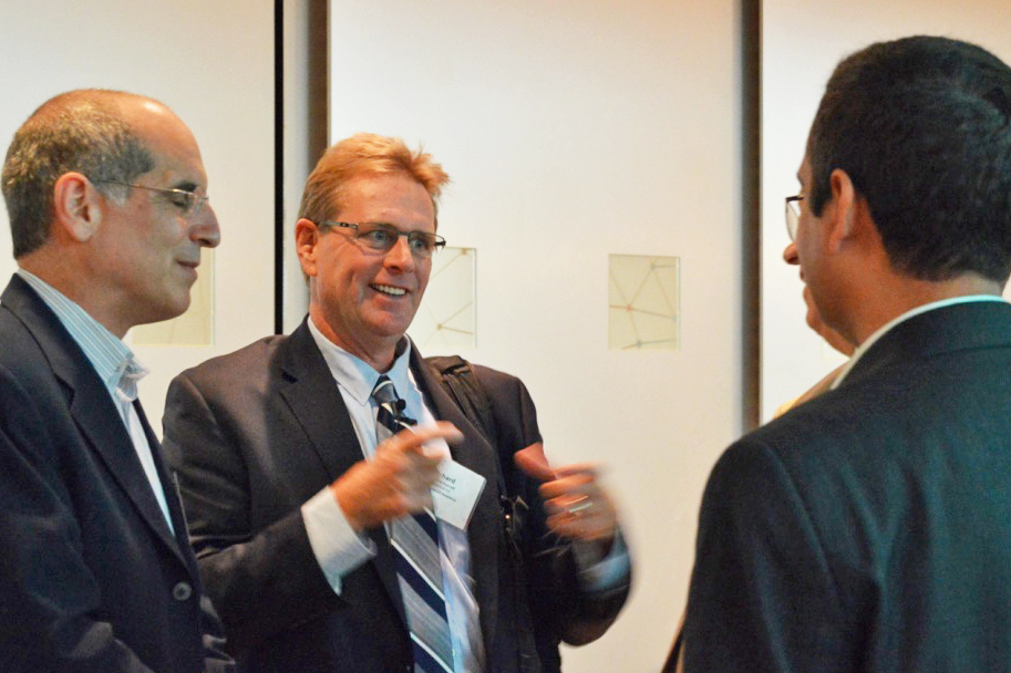 Rick Weiss & Richard Purcell speaking with attendees.