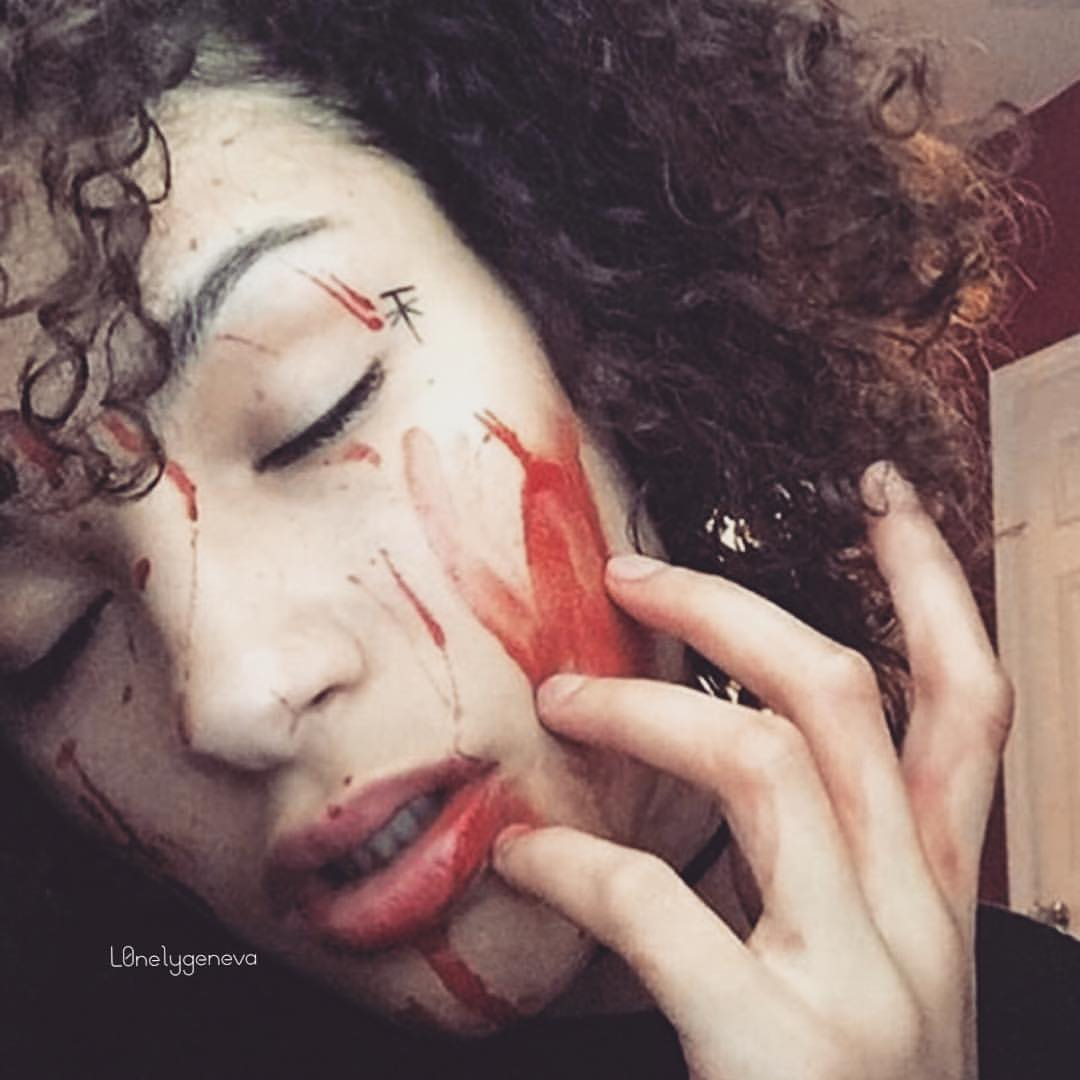 Geneva styles herself with fake blood on Instagram post, circa late 2018.