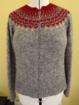 My sweater, washed and blocked with a single purl stitch running up the length of the sweater