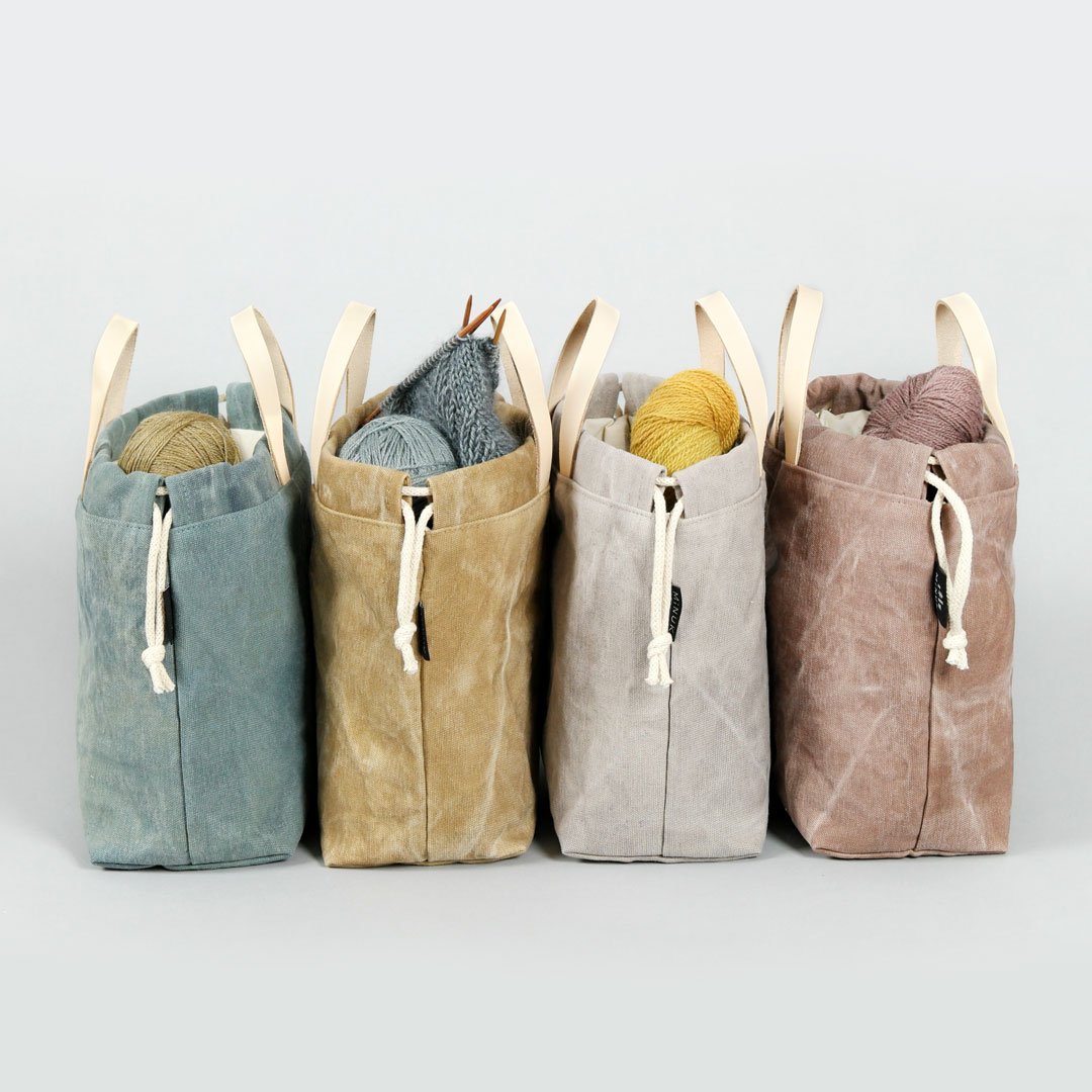 HEY MAMA WOLF & MINUK  Hey Mama Wolf and  Minuk  cooked up an awesome collection of project bags exclusively for EYF 2019. We dyed and printed the canvas with botanical dyes. Antje from Minuk brings also some of her beautiful leather bags and knitterly themed pins.