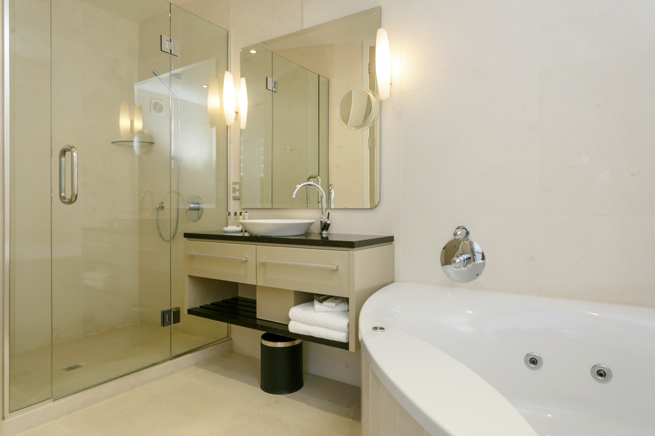 Ground floor two bedroom apartment master bedroom ensuite bathroom with spa bath 1.jpg