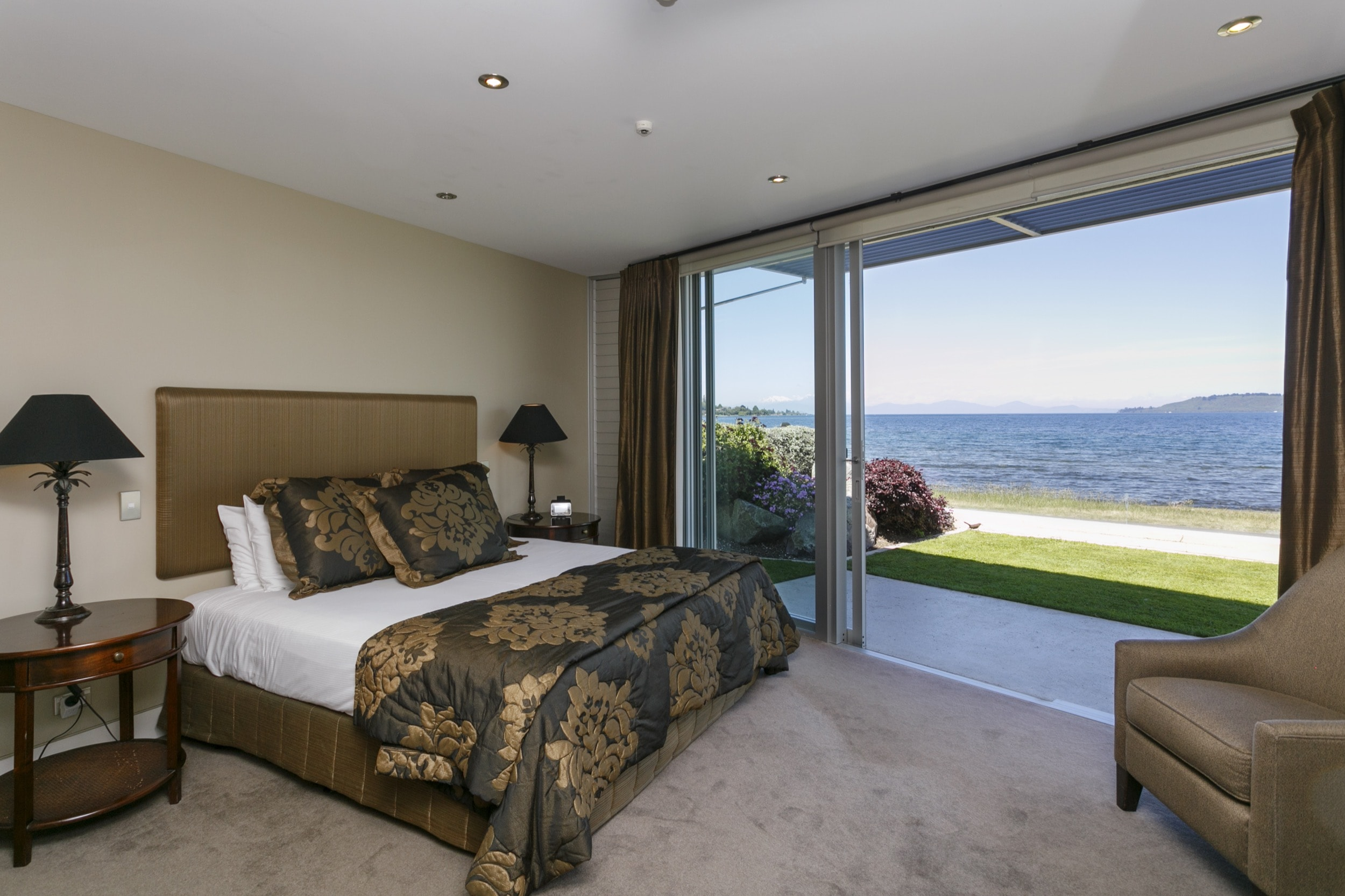 Ground floor two bedroom apartment master bedroom looking out onto lakefront view.jpg
