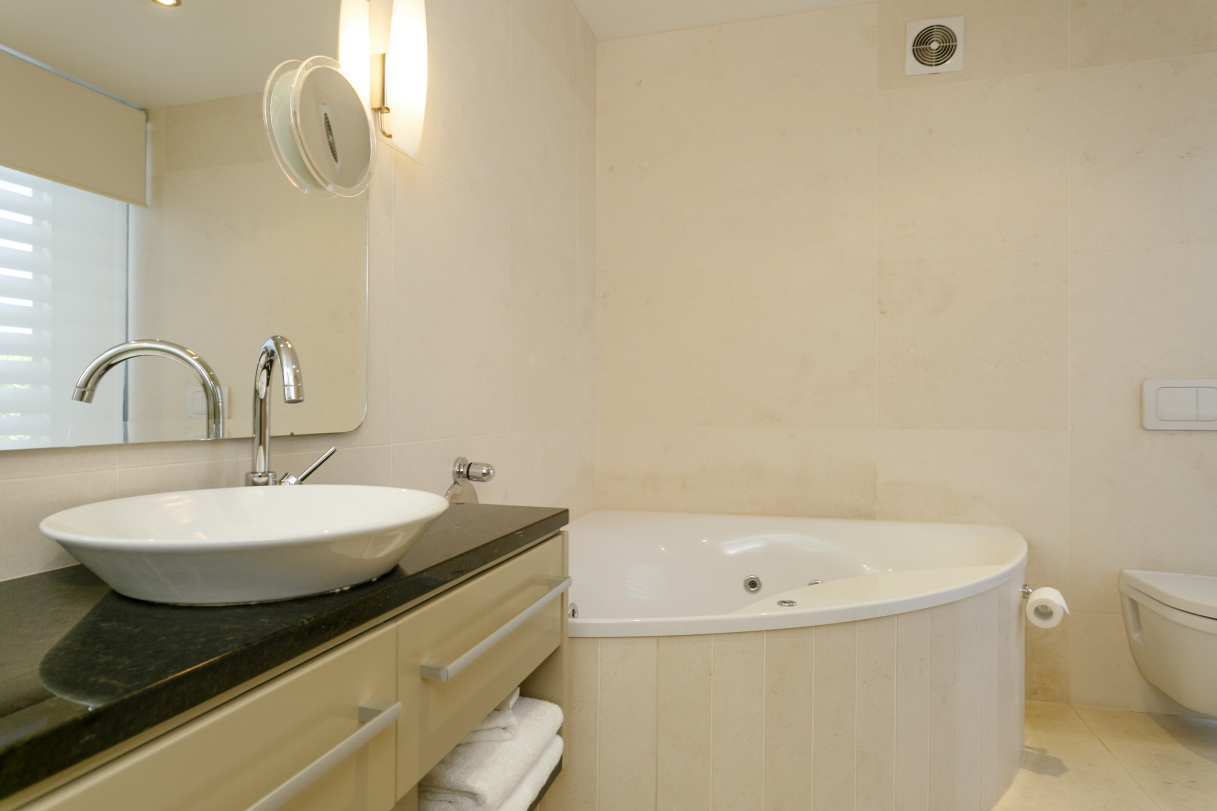 Ground floor two bedroom apartment master bedroom ensuite bathroom with spa bath 2.jpg