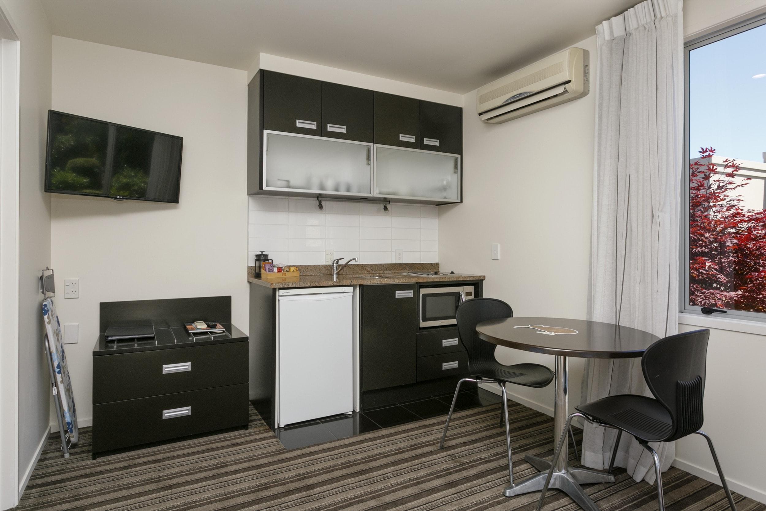 One Bedroom Gardev View living area looking at kitchenette-min.jpg