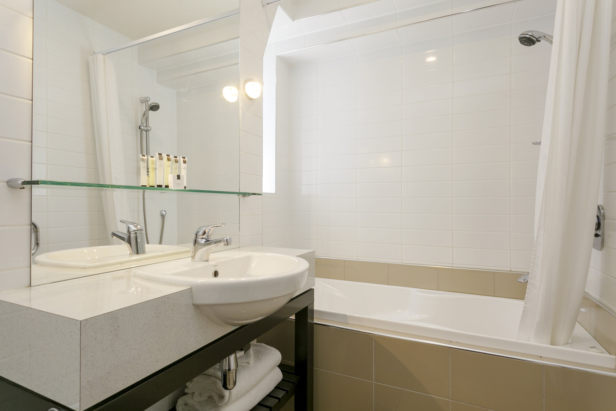 One Bedroom with Lake Views Bedroom bathroom with spa bath.jpg