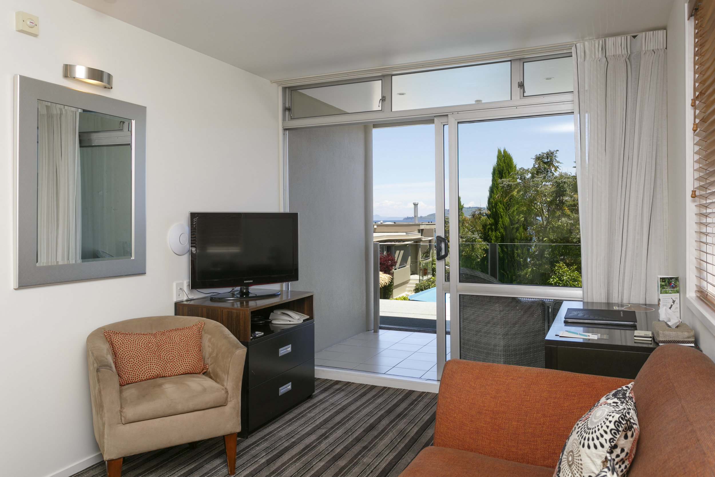 One Bedroom with limited Lake Views Bedroom living area and balcony.jpg