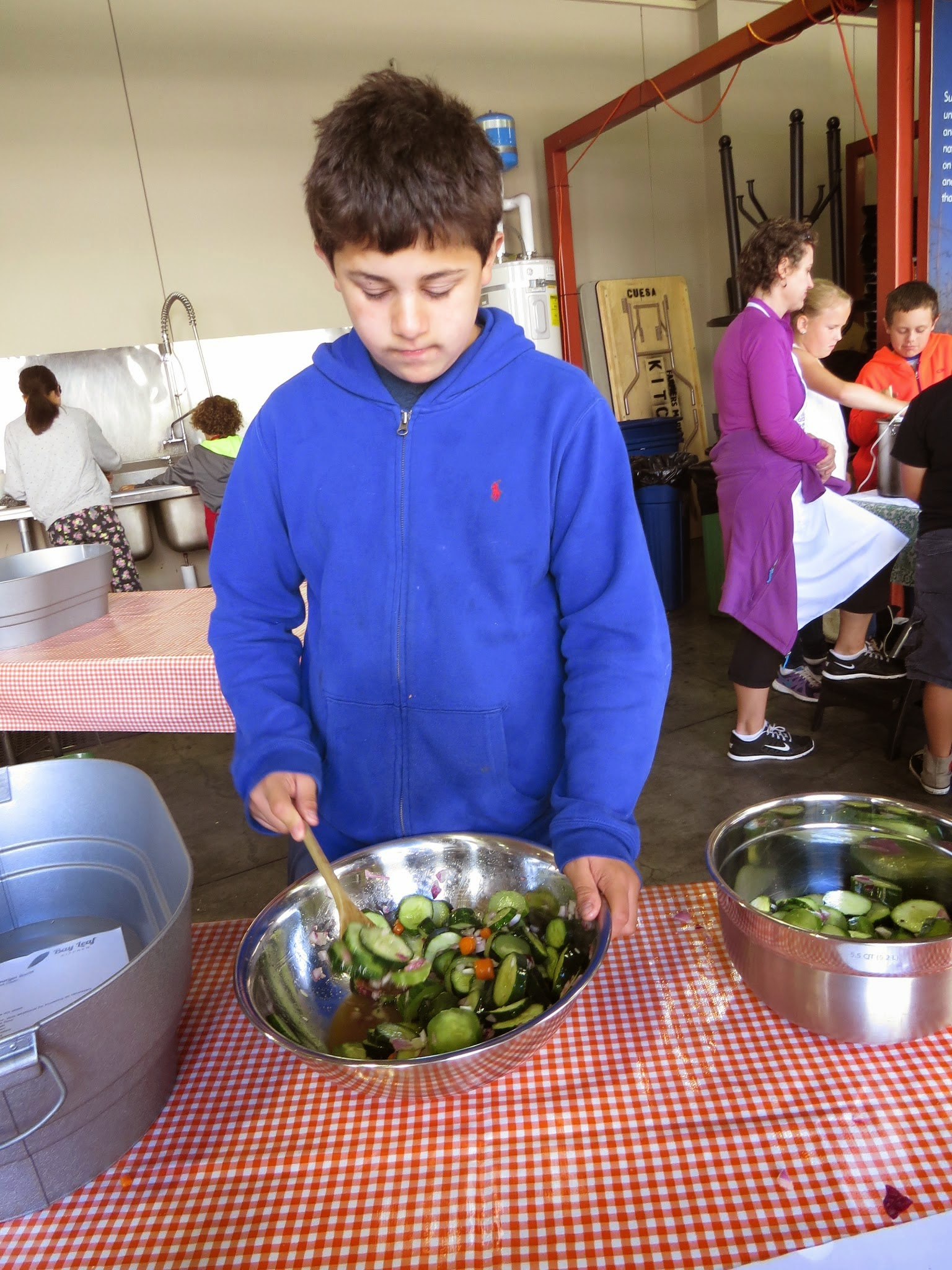 Gabe making sweet and sour quick pickles during camp.