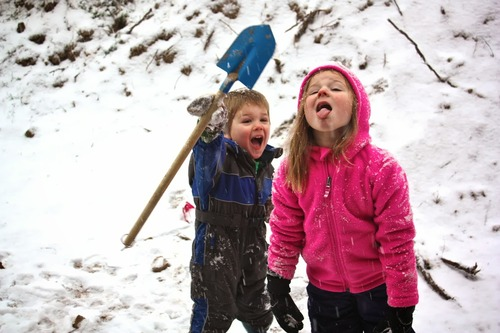 Photo of my nephew Ezra & niece Piper, taking life really seriously this winter.