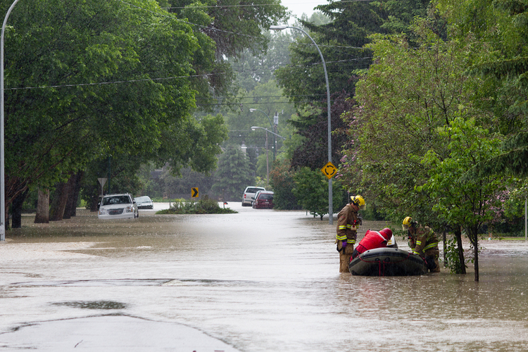 rescue workers helping people during flood