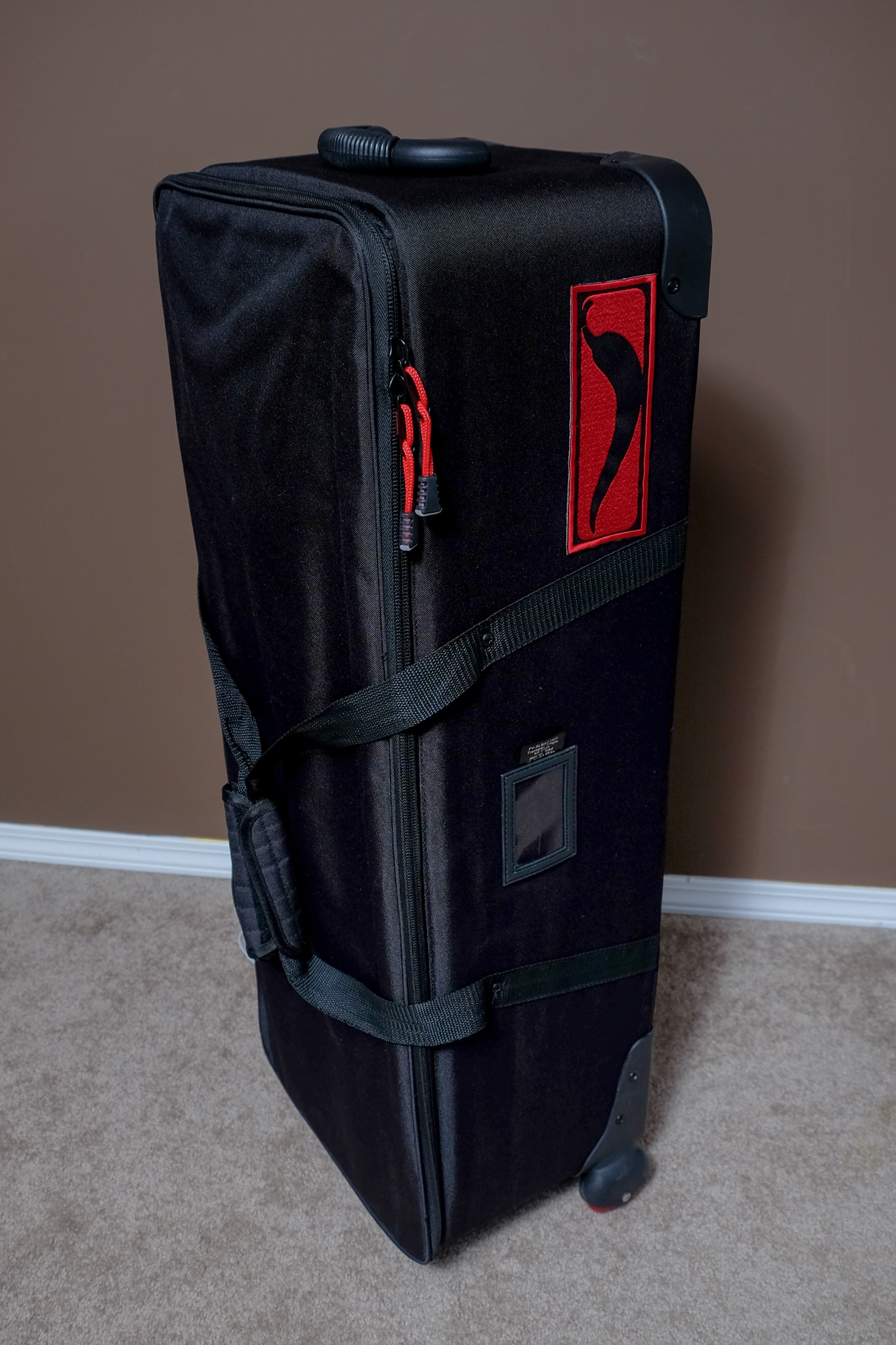 It's about as large as an oversizedgolf bag - but with a square footprint and wheels.