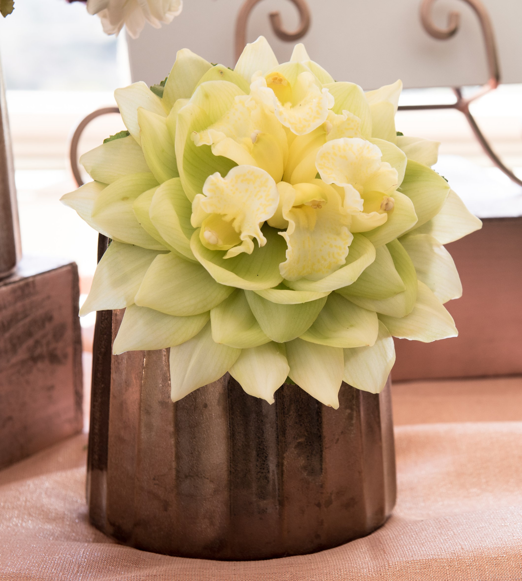 A modern take on yellow, green, and white - the composite bouquet designed with cymbidium orchids.  Photo by  Kelly Waterman Photography   Venue:   Bella Collina, San Clemente