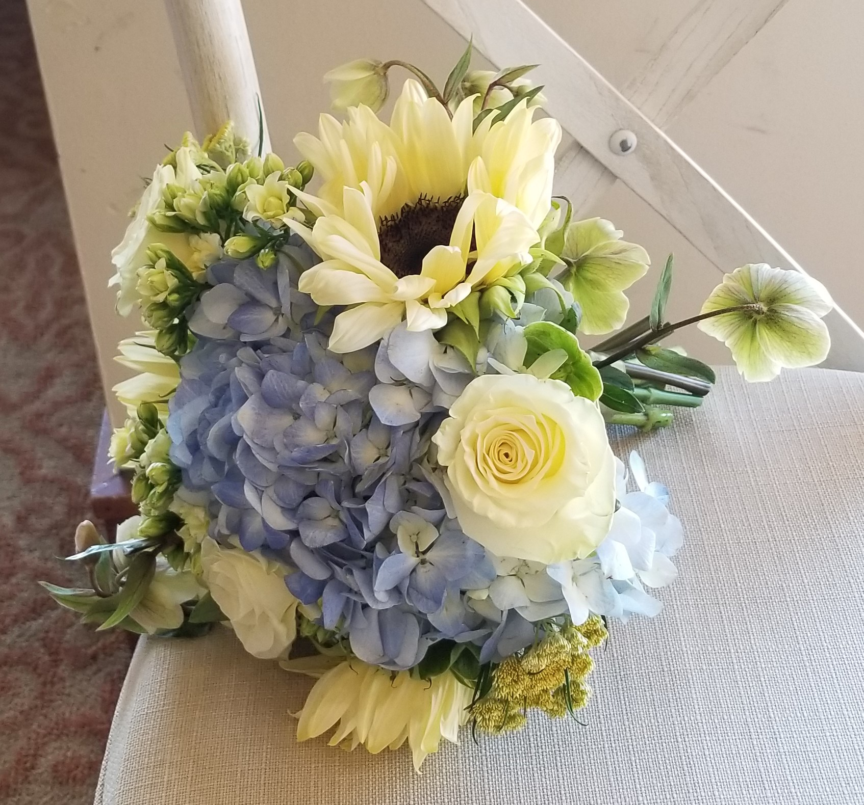 The softer side of yellow, blue, green, and white.  A charming spring hand-tied bouquet.  Venue:   Mission Viejo Country Club