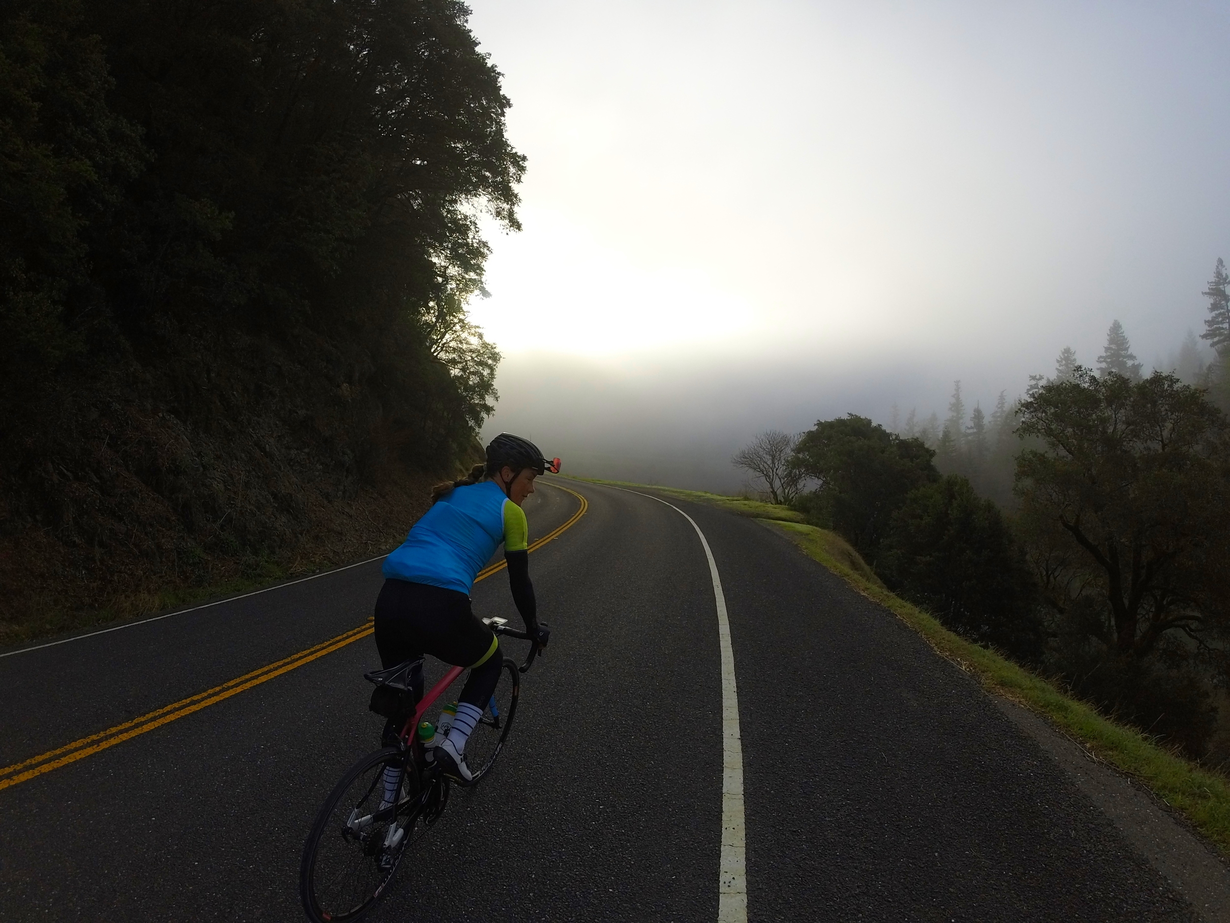 Olivia was a pop of color among the fog in the Citrine ES Jersey & bibs and the cyan wind vest!