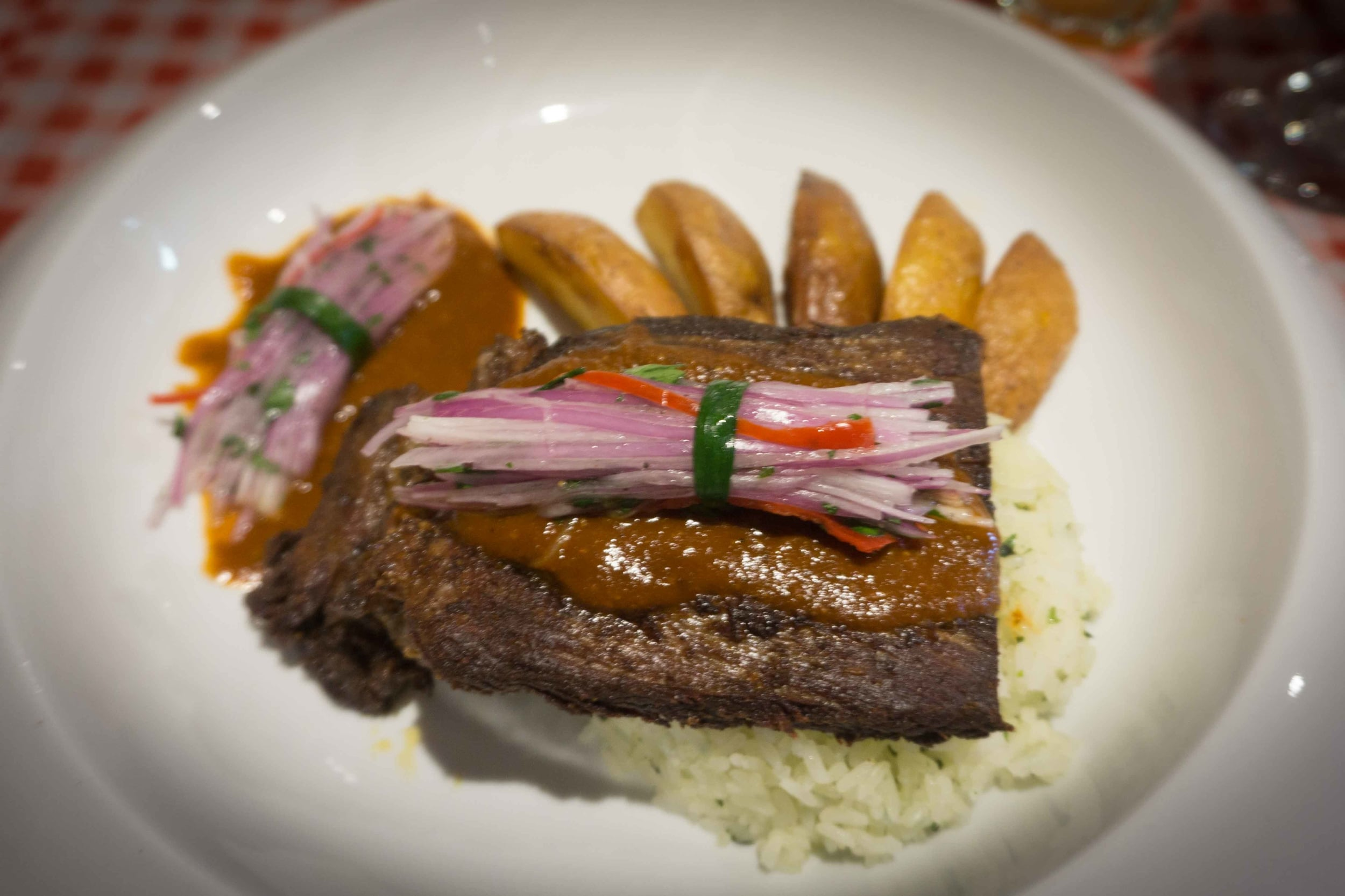 Alpaca steak  with pickled onions and fingerling potatoes