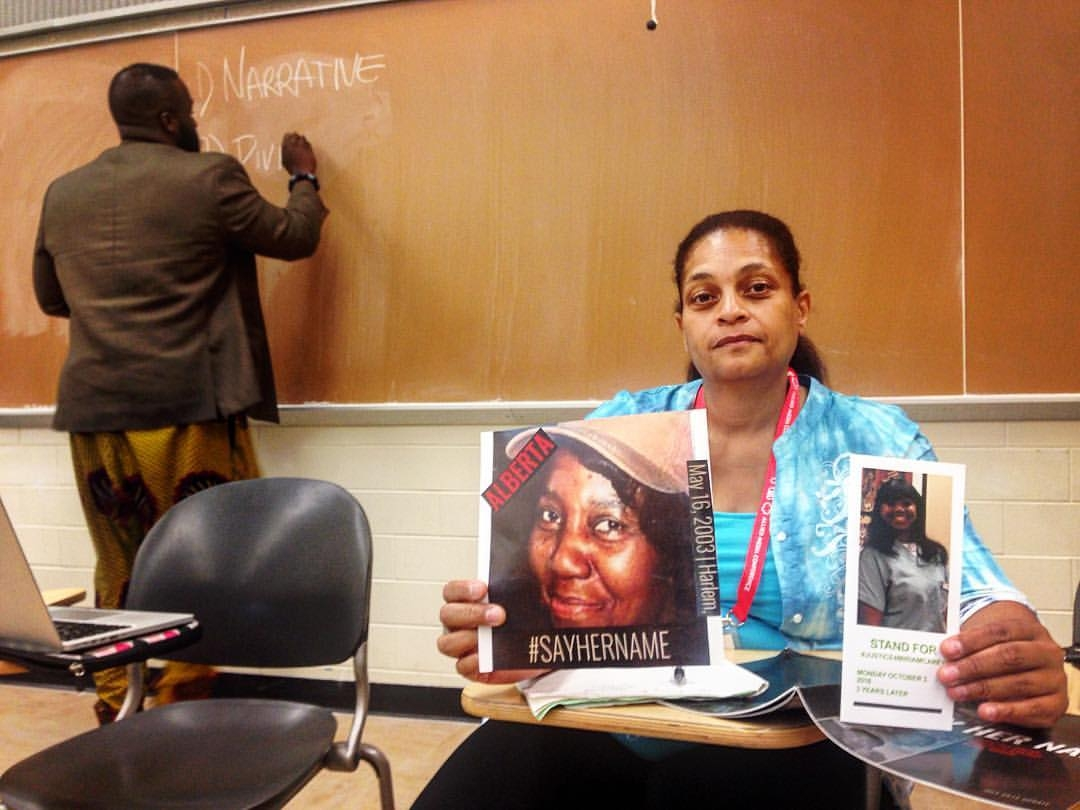 """Cynthia Howell holding up her aunt's picture, police murder victim Alberta Spruill, with Allen of BLM-NY/Movement Lab writing on the board for our Police Brutality workshop series, """"When GoFundMe Doesn't Cut It"""" and the Forced Trajectory Project screening."""