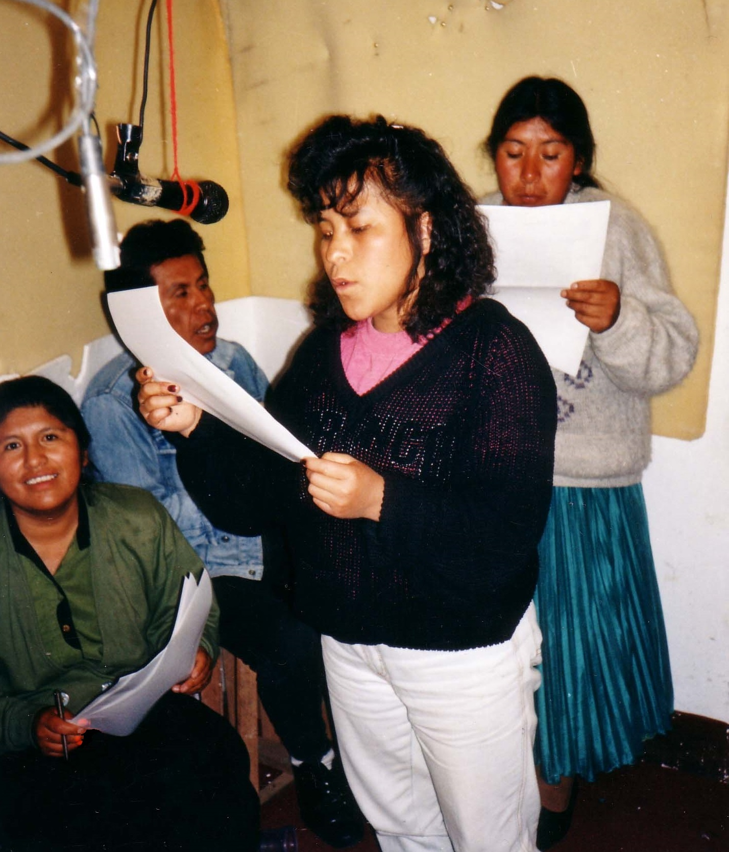 Recording the Tuturani radionovela in the THOA recording studio in 1991, with Valentina Jacha Collo (center, at the microphone), María Eugenia Choque (left), and Nicanor Huanta and Lucia Quispe (back). Courtesy of the Andean Oral History Workshop.