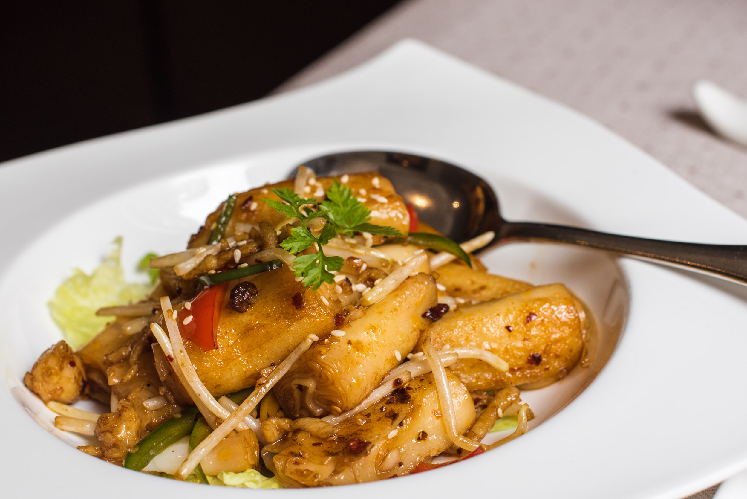 Wok-fried Cheng Fun with shredded Chicken, Bean Sprouts and Lettuce in Spicy Sauce