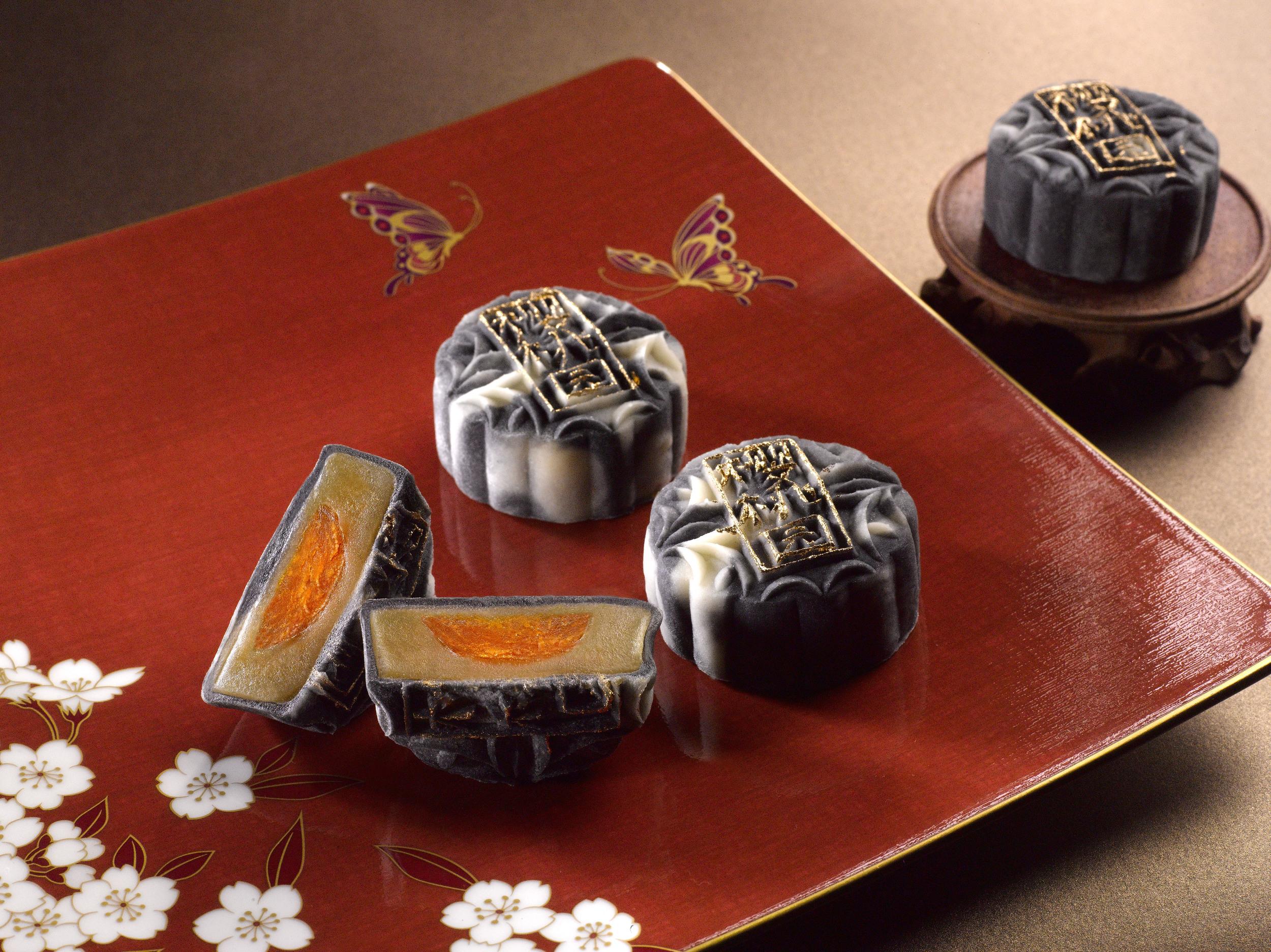Charcoal Snow Skin Mooncake with Truffle Oil, Lotus Paste and Egg Yolk   Photo Credit: Mandarin Oriental, Singapore