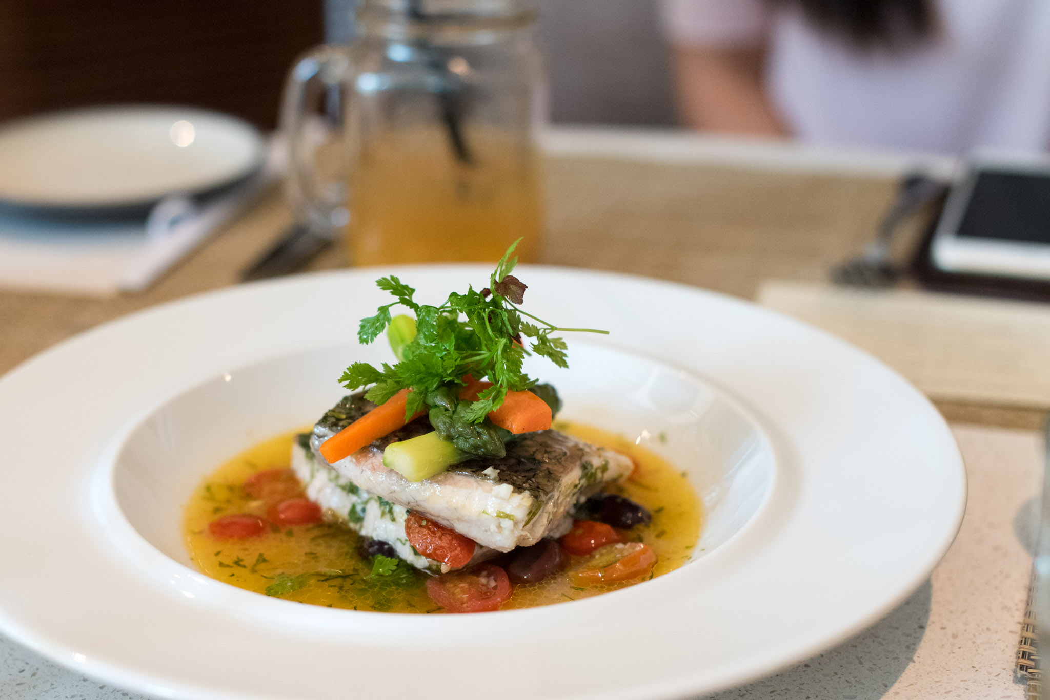Neapolitan Style Sea Bass Cooked with Cherry Tomatoes, Capers, Wine and Basil  The Waterfall - Shangri-La Singapore