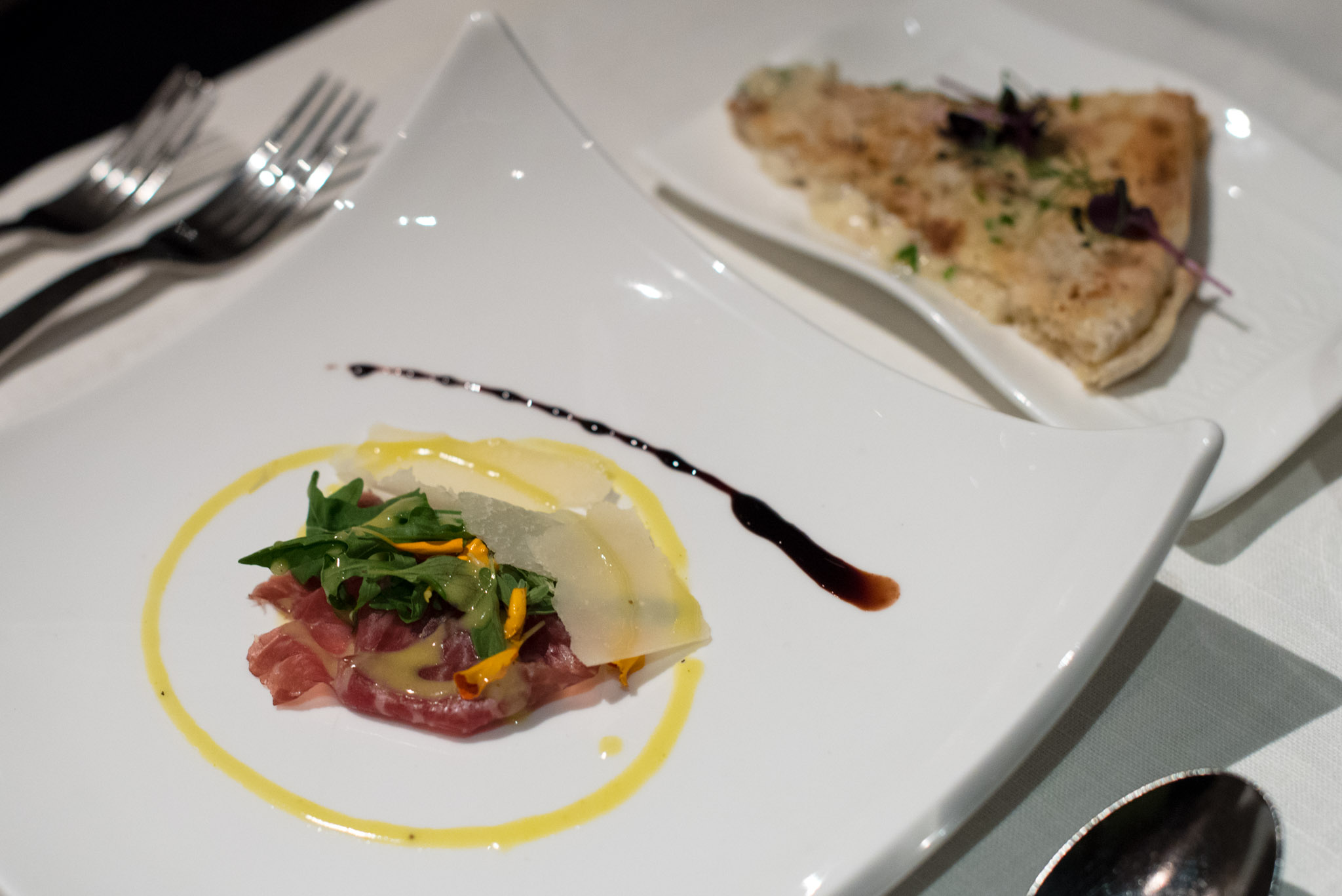 Front: 60-day Cured Wagyu Beef with 40-month Aged Parmesan Cheese and Summer Salad with Amalfi Lemon Dressing (S$31++) | Back: Focaccia Mascarpone  Basilico - Regent Singapore