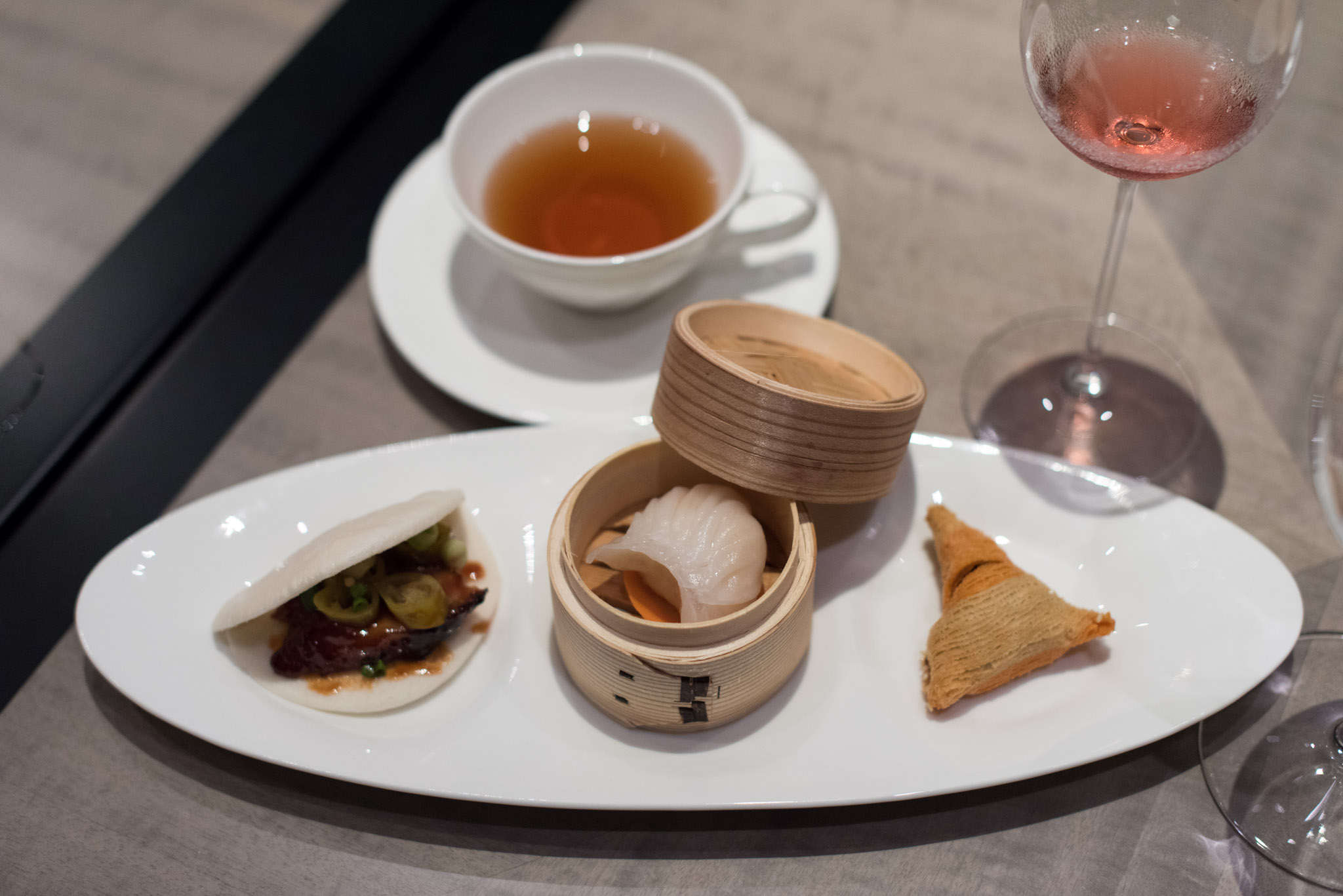 From Left: Char Siew Sliders with Homemade Pickled Green Chili (S$15++ per Serving), Steamed Shrimp Dumpling with Mushroom (S$2++ per Piece) and Crispy Flaky Pastry with Black Pepper Beef (S$3++ per Piece)  Jiang-Nan Chun - Four Seasons Hotel Singapore