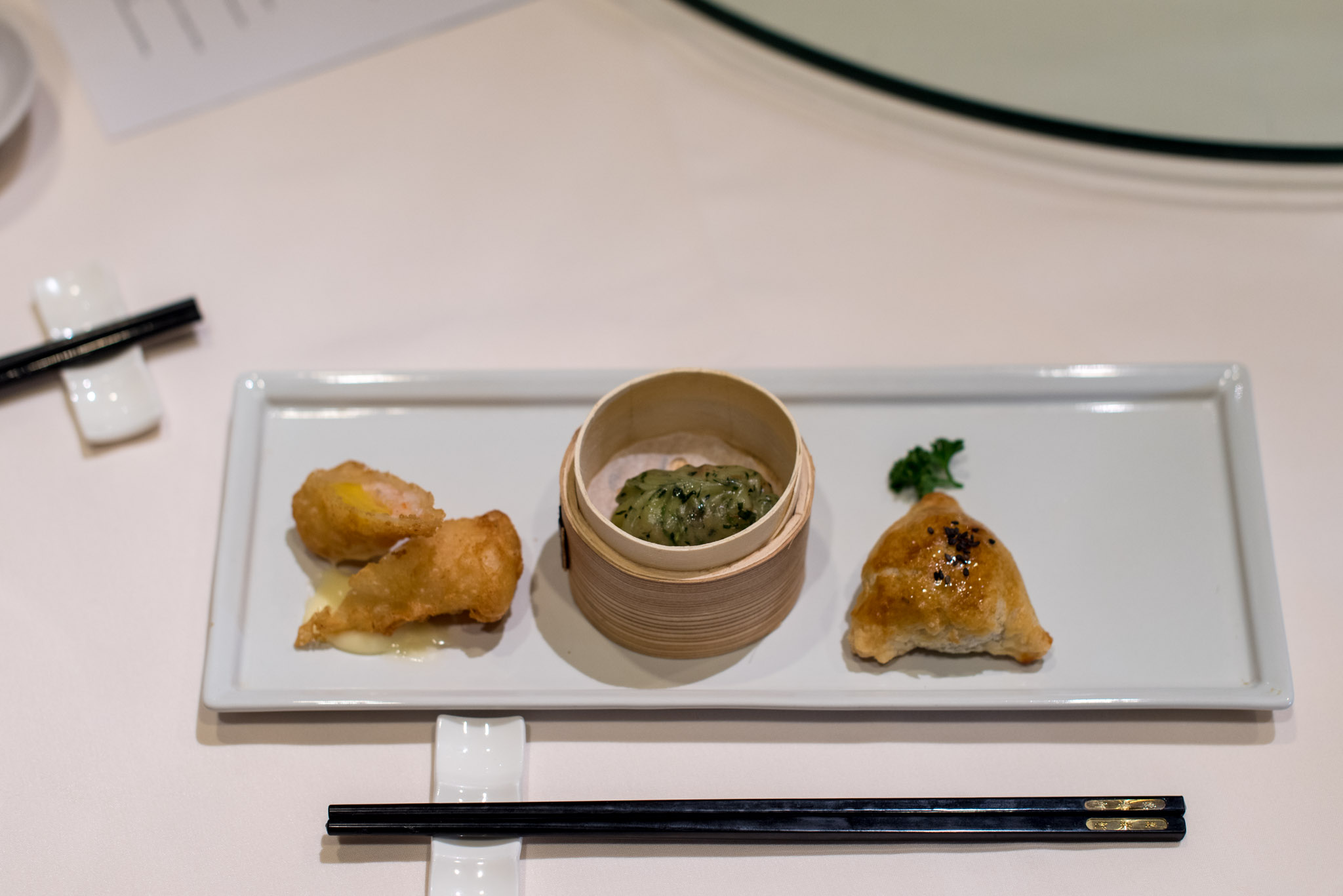 Deep-fried Mango Roll (S$5++ for two), Steamed Crystal Skin Vegetarian Dumpling (S$4++ for two), Baked Crispy Honey-Glazed Pork Puff with Black Pepper Sauce (S$5++ for two)  Wan Hao - Singapore Marriott Tang Plaza Hotel