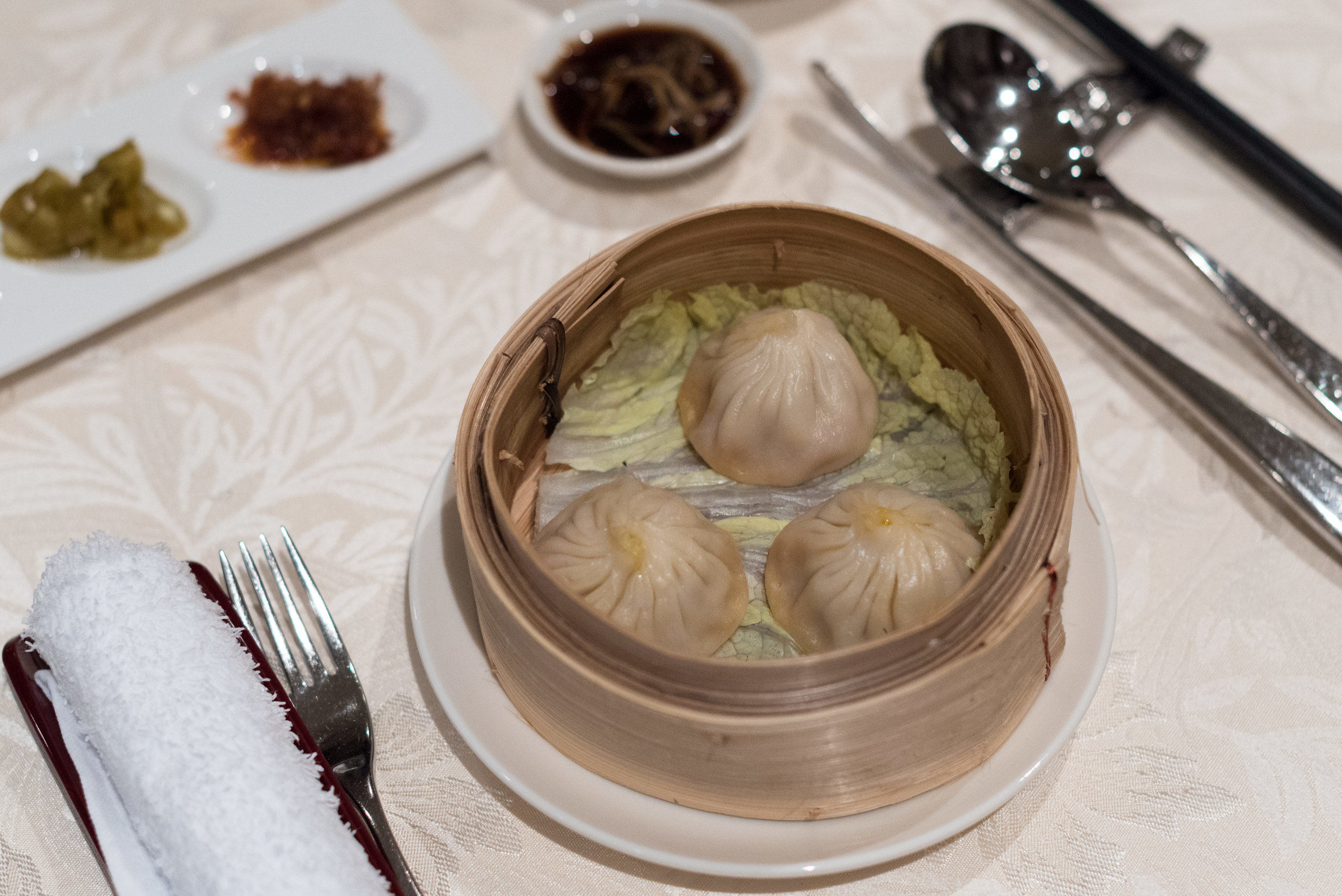Steamed Minced Pork Dumplings with Hairy Crab Meat and Roe (蟹粉灌汤小籠包)  Hai Tien Lo - Pan Pacific Singapore