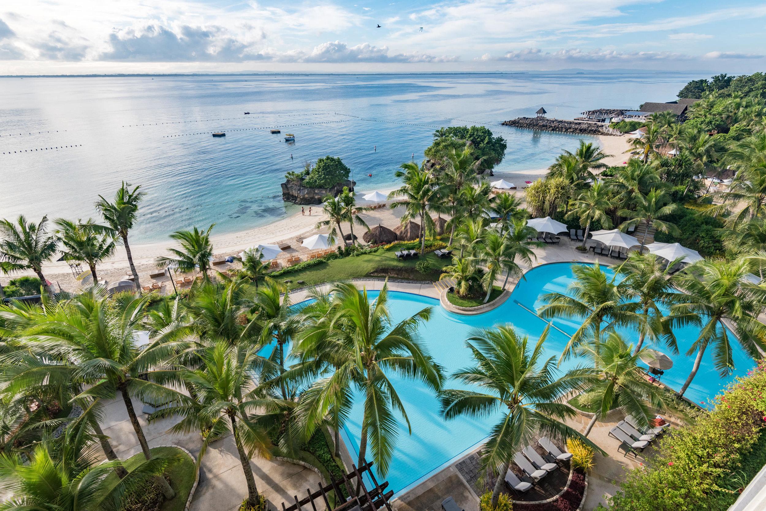 View of Swimming Pool from Balcony - Ocean Wing Panorama Room  Shangri-La's Mactan Resort and Spa, Cebu