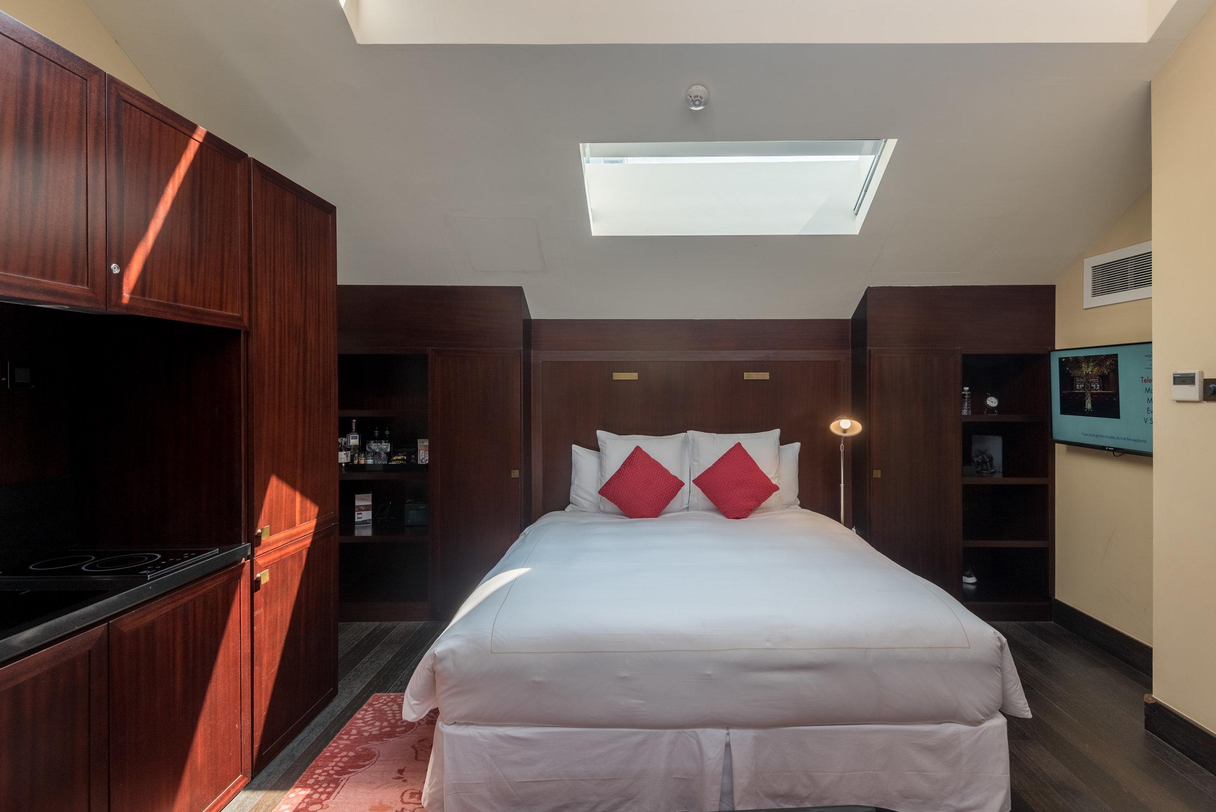 Bed with Skylight  Art Executive Club Suite - The Vagabond Club, A Tribute Portfolio Hotel, Singapore