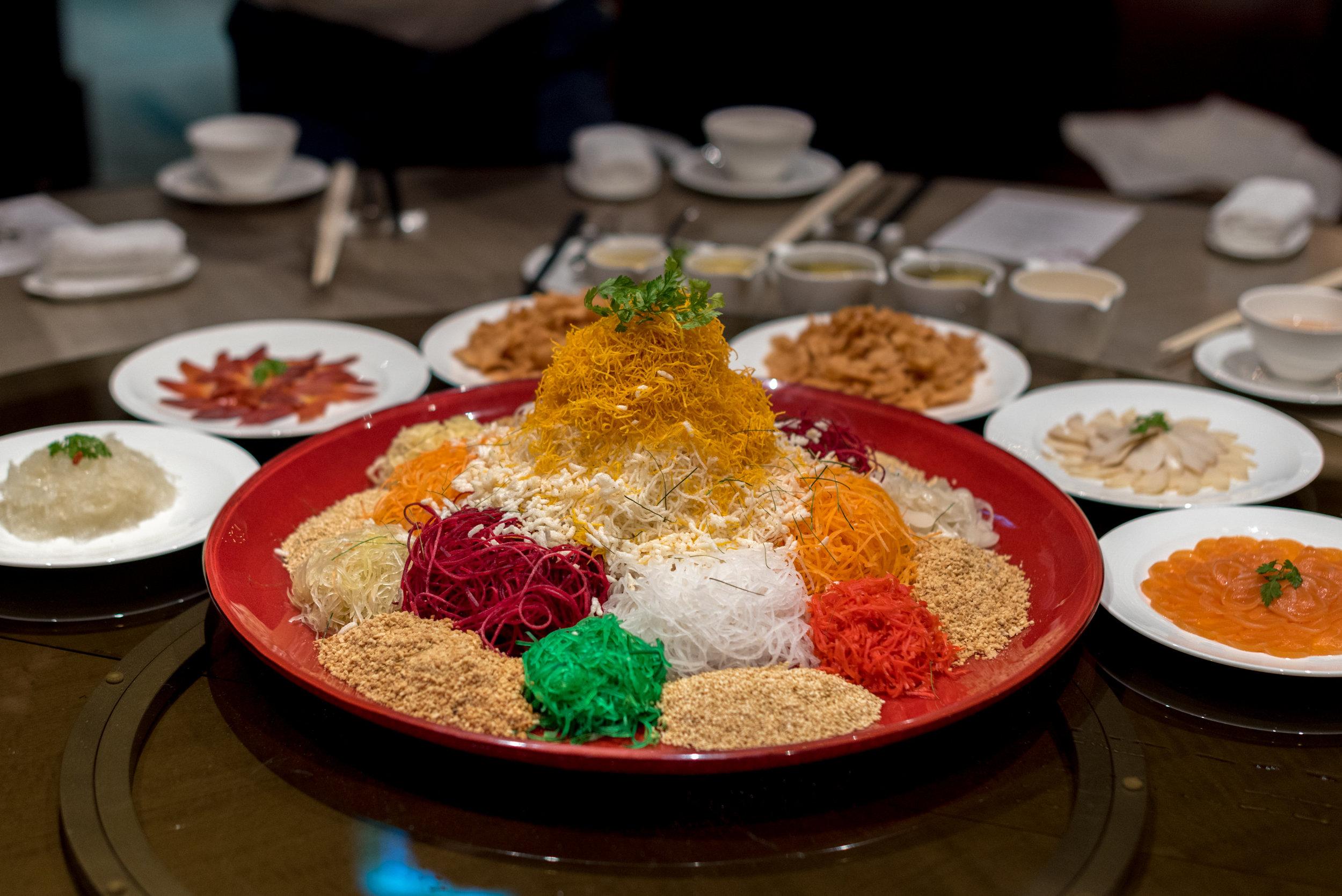 Prosperity Salmon Yu Sheng with Abalone, Japanese Surf Clams and Bird's Nest  Jiang-Nan Chun - Four Seasons Hotel Singapore