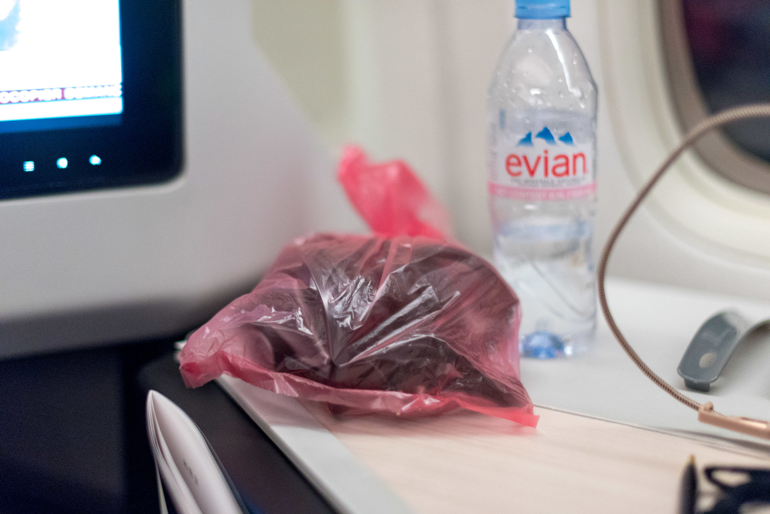 Headphones in Plastic Bag  Japan Airlines Business Class JL36 777-200ER - SIN to HND