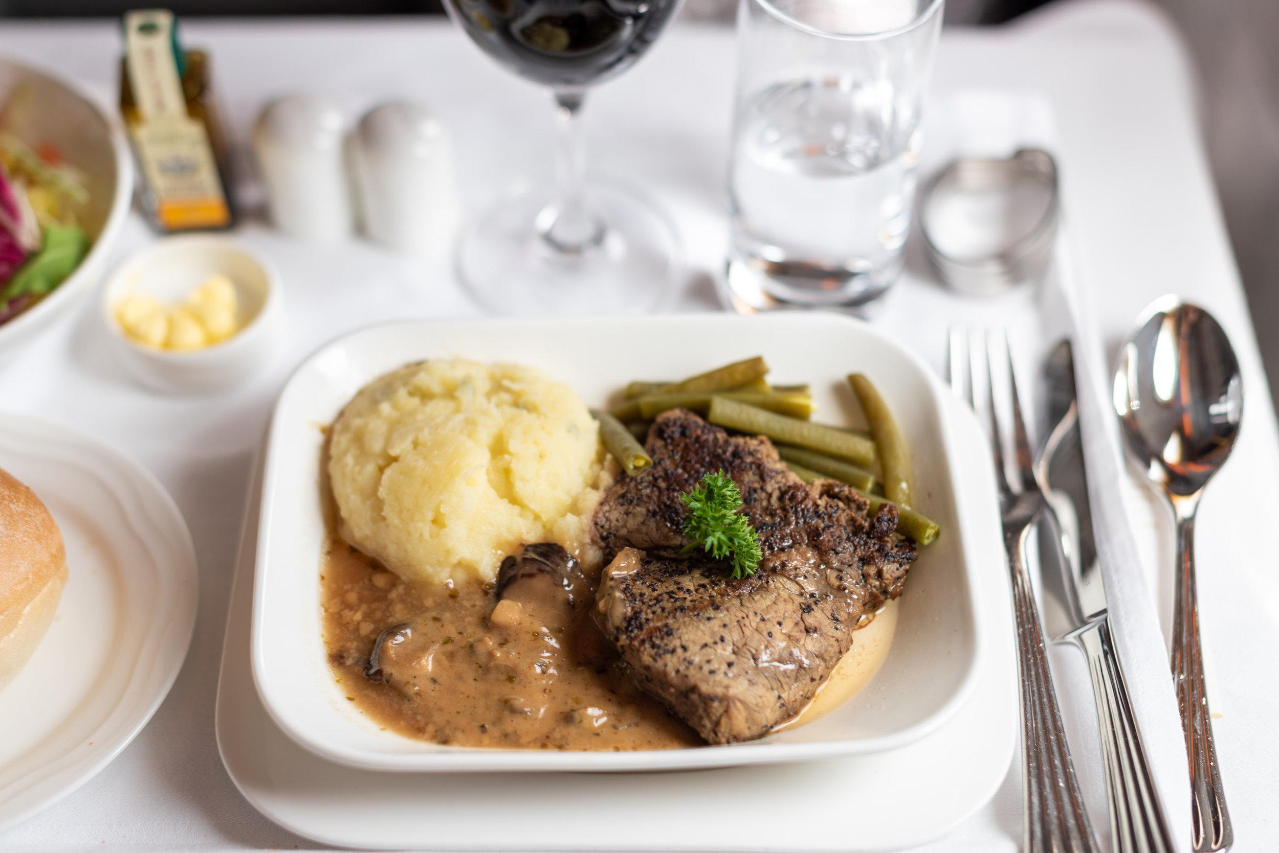 Lunch Service - Seared Beef Tenderloin  Emirates Business Class 777-300ER - SIN to DXB